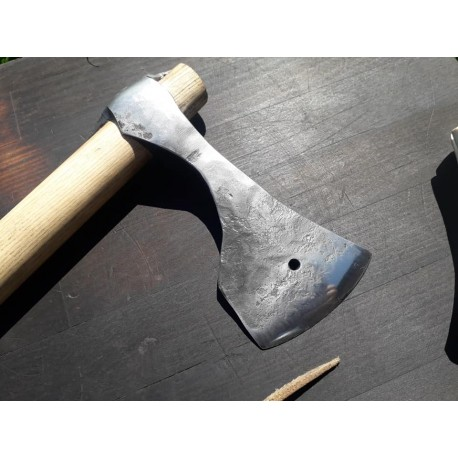 """Hand forged axe with antler """"scarbard""""."""